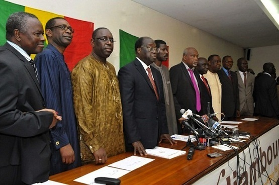 Eight members of the Senegalese opposition, (From L to R) Alioune Tine, Youssou N'Dour, Macky Sall, Moustapha Niasse, Talla Sylla, Amath Danssoko, Idrissa Secke, Cheikh Tidjane Gadio, Tanor Dieng and Cheikh Bamba Dieye, stand together during a press conference in Dakar, on February 4, 2012. The eight opposition candidates, running in Senegal's presidential election, pledged today to take joint action to block President Abdoulaye Wade from standing for a third term in office.  AFP/PHOTO / SEYLLOU (Photo credit should read SEYLLOU/AFP/Getty Images)